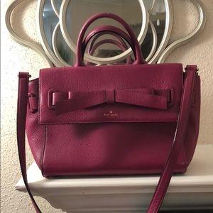 Pink Kate Spade satchel handbag with bow